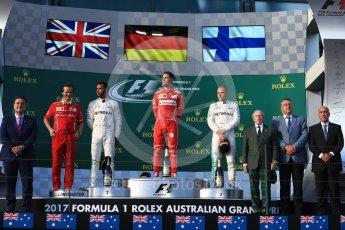 World © Octane Photographic Ltd. Formula 1 - Australian Grand Prix - Podium. Sebastian Vettel - Scuderia Ferrari SF70H, Lewis Hamilton and Valtteri Bottas - Mercedes AMG Petronas F1 W08 EQ Energy+. Albert Park Circuit. Sunday 26th March 2017. Digital Ref: 1803LB1D7412
