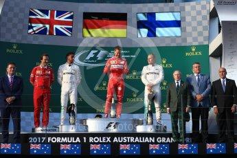 World © Octane Photographic Ltd. Formula 1 - Australian Grand Prix - Podium. Sebastian Vettel - Scuderia Ferrari SF70H, Lewis Hamilton and Valtteri Bottas - Mercedes AMG Petronas F1 W08 EQ Energy+. Albert Park Circuit. Sunday 26th March 2017. Digital Ref: 1803LB1D7442
