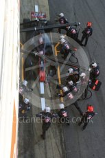 World © Octane Photographic Ltd. Formula 1 - Winter Test 2. Romain Grosjean - Haas F1 Team VF-17 and team doing a pit stop. Circuit de Barcelona-Catalunya. Friday 10th March 2017. Digital Ref: 1787LB5D0133