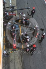 World © Octane Photographic Ltd. Formula 1 - Winter Test 2. Romain Grosjean - Haas F1 Team VF-17 and team doing a pit stop. Circuit de Barcelona-Catalunya. Friday 10th March 2017. Digital Ref: 1787LB5D0150