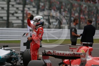 World © Octane Photographic Ltd. Formula 1 - Japanese Grand Prix - Saturday - Qualifying. Sebastian Vettel - Scuderia Ferrari SF70H on track to be interviewed. Suzuka Circuit, Suzuka, Japan. Saturday 7th October 2017. Digital Ref:1977LB2D5088