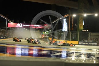 World © Octane Photographic Ltd. Formula 1 - Singapore Grand Prix - Race. The damaged Scuderia Ferrari SF70H makes contact with the Red Bull Racing RB13 of Max Verstappen who in turn hits the McLaren MCL32 of Fernando Alonso. Marina Bay Street Circuit, Singapore. Sunday 17th September 2017. Digital Ref: