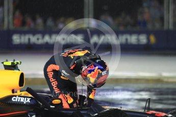 World © Octane Photographic Ltd. Formula 1 - Singapore Grand Prix - Race. Max Verstappen climbs out of his car at turn 1 lap 1 - Red Bull Racing RB13. Marina Bay Street Circuit, Singapore. Sunday 17th September 2017. Digital Ref: