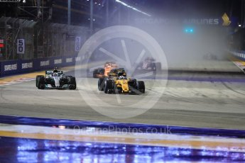 World © Octane Photographic Ltd. Formula 1 - Singapore Grand Prix - Race. Jolyon Palmer - Renault Sport F1 Team R.S.17 and Valtteri Bottas - Mercedes AMG Petronas F1 W08 EQ Energy+. . Marina Bay Street Circuit, Singapore. Sunday 17th September 2017. Digital Ref:
