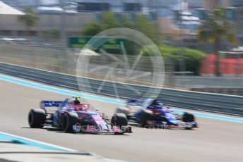 World © Octane Photographic Ltd. Formula 1 –  Abu Dhabi GP - Practice 1. Racing Point Force India VJM11 - Esteban Ocon and Scuderia Toro Rosso STR13 – Pierre Gasly. Yas Marina Circuit, Abu Dhabi. Friday 23rd November 2018.