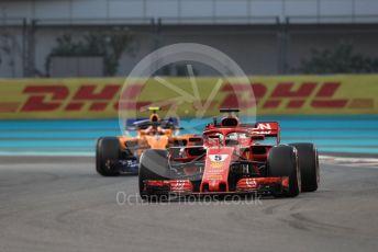 World © Octane Photographic Ltd. Formula 1 –  Abu Dhabi GP - Practice 2. Scuderia Ferrari SF71-H – Sebastian Vettel and McLaren MCL33 – Stoffel Vandoorne. Yas Marina Circuit, Abu Dhabi. Friday 23rd November 2018.