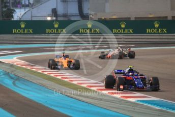 World © Octane Photographic Ltd. Formula 1 – Abu Dhabi GP - Race. Scuderia Toro Rosso STR13 – Pierre Gasly, McLaren MCL33 – Fernando Alonso and Haas F1 Team VF-18 – Kevin Magnussen. Yas Marina Circuit, Abu Dhabi. Sunday 25th November 2018.