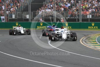 World © Octane Photographic Ltd. Formula 1 – Australian GP - Race. Alfa Romeo Sauber F1 Team C37 – Marcus Ericsson and Charles Leclerc either side of Scuderia Toro Rosso STR13 – Pierre Gasly. Albert Park, Melbourne, Australia. Sunday 25th March 2018.