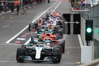 World © Octane Photographic Ltd. Formula 1 – Belgian GP - Qualifying. Mercedes AMG Petronas Motorsport AMG F1 W09 EQ Power+ - Valtteri Bottas at the front of the queue waiting on green light. Spa-Francorchamps, Belgium. Saturday 25th August 2018.