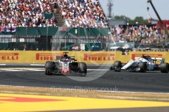 World © Octane Photographic Ltd. Formula 1 – British GP - Race. Haas F1 Team VF-18 – Romain Grosjean and Alfa Romeo Sauber F1 Team C37 – Marcus Ericsson. . Silverstone Circuit, Towcester, UK. Sunday 8th July 2018.