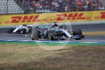 World © Octane Photographic Ltd. Formula 1 – German GP - Race. Mercedes AMG Petronas Motorsport AMG F1 W09 EQ Power+ - Lewis Hamilton and Alfa Romeo Sauber F1 Team C37 – Charles Leclerc. Hockenheimring, Baden-Wurttemberg, Germany. Sunday 22nd July 2018.