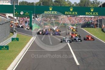 World © Octane Photographic Ltd. Formula 1 – Hungarian GP - Race. Mercedes AMG Petronas Motorsport AMG F1 W09 EQ Power+ - Lewis Hamilton leads the pack into Turn 1. Hungaroring, Budapest, Hungary. Sunday 29th July 2018.