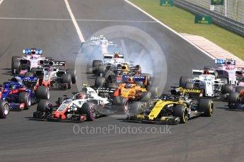 World © Octane Photographic Ltd. Formula 1 – Hungarian GP - Race. Alfa Romeo Sauber F1 Team C37 – Charles Leclerc locks a brake while Marcus Ericsson gets launched . Hungaroring, Budapest, Hungary. Sunday 29th July 2018.