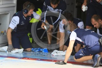 World © Octane Photographic Ltd. Formula 1 – Hungarian Post-Race Test - Day 1. Williams Martini Racing clear the garage floor of excess aeroflow paint. Hungaroring, Budapest, Hungary. Tuesday 31st July 2018.