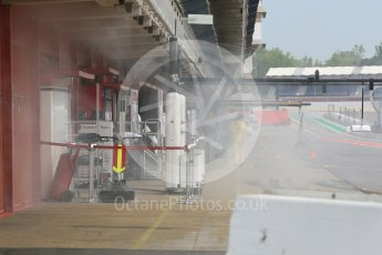 World © Octane Photographic Ltd. Formula 1 – In season test 1, day 2. Alfa Romeo Sauber F1 Team C37 garage - smoking after engine start. Circuit de Barcelona-Catalunya, Spain. Wednesday 16th May 2018.