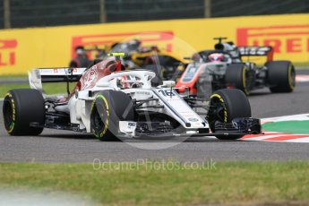 World © Octane Photographic Ltd. Formula 1 – Japanese GP - Practice 1. Alfa Romeo Sauber F1 Team C37 – Charles Leclerc and Haas F1 Team VF-18 – Romain Grosjean. Suzuka Circuit, Japan. Friday 5th October 2018.
