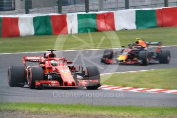 World © Octane Photographic Ltd. Formula 1 – Japanese GP - Practice 2. Scuderia Ferrari SF71-H – Sebastian Vettel and Aston Martin Red Bull Racing TAG Heuer RB14 – Max Verstappen. Suzuka Circuit, Japan. Friday 5th October 2018.