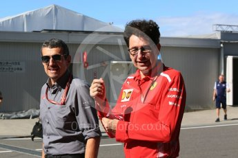 World © Octane Photographic Ltd. Formula 1 - Japanese GP - Paddock. Guenther Steiner - Team Principal of Haas F1 Team and Mattia Binotto – Chief Technical Officer - Scuderia Ferrari. Suzuka Circuit, Japan. Sunday 7th October 2018.