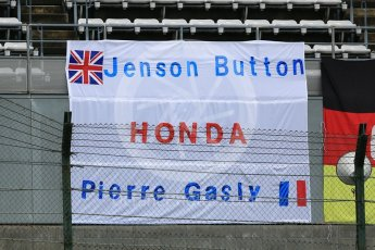 World © Octane Photographic Ltd. Formula 1 – Japanese GP. Scuderia Toro Rosso fans's banner – Pierre Gasly and Jenson Button..... Suzuka Circuit, Japan. Thursday 4th October 2018.