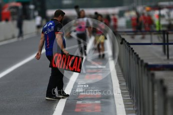 "World © Octane Photographic Ltd. Formula 1 – Japanese GP - Pit Lane. Toro Rosso mechanic with ""Critical"" pit board. Suzuka Circuit, Japan. Thursday 4th October 2018."