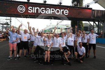 World © Octane Photographic Ltd. Formula 1 – Singapore GP - Thursday Pit Lane. Formula 1 in Schools group photo (Staff). Marina Bay Street Circuit, Singapore. Thursday 13th September 2018.