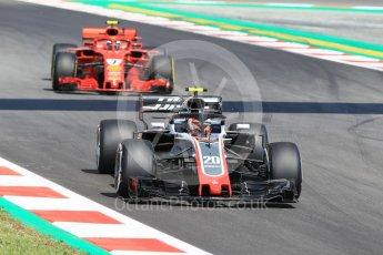 World © Octane Photographic Ltd. Formula 1 – Spanish GP - Practice 1. Haas F1 Team VF-18 – Kevin Magnussen and Scuderia Ferrari SF71-H – Kimi Raikkonen. Circuit de Barcelona-Catalunya, Spain. Friday 11th May 2018.