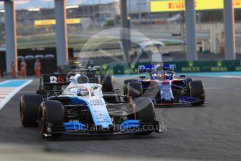 World © Octane Photographic Ltd. Formula 1 – Abu Dhabi GP - Practice 2. Haas F1 Team VF19 – Kevin Magnussen, Scuderia Toro Rosso STR14 – Daniil Kvyat and ROKiT Williams Racing FW 42 – George Russell. Yas Marina Circuit, Abu Dhabi, UAE. Friday 29th November 2019.