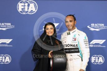World © Octane Photographic Ltd. Formula 1 – Abu Dhabi GP - Qualifying. Mercedes AMG Petronas Motorsport AMG F1 W10 EQ Power+ - Lewis Hamilton receives the Pirelli Pole Position Award from the Pirelli Representative, FIA Women in Motorsport Commission member and Saudi Arabian racing driver Aseel Al Hamad. Yas Marina Circuit, Abu Dhabi, UAE. Saturday 30th November 2019.