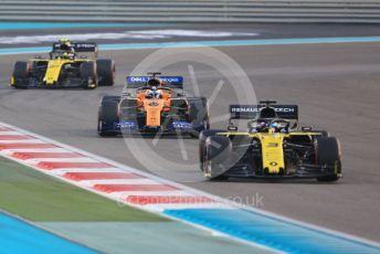 World © Octane Photographic Ltd. Formula 1 – Abu Dhabi GP - Race. Renault Sport F1 Team RS19 – Daniel Ricciardo and Nico Hulkenberg sandwiching the McLaren MCL34 of Carlos Sainz. Yas Marina Circuit, Abu Dhabi, UAE. Sunday 1st December 2019.