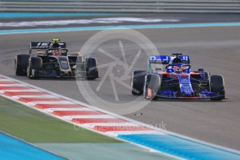 World © Octane Photographic Ltd. Formula 1 – Abu Dhabi GP - Race. Scuderia Toro Rosso STR14 – Daniil Kvyat and Haas F1 Team VF19 – Kevin Magnussen. Yas Marina Circuit, Abu Dhabi, UAE. Sunday 1st December 2019.