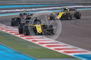 World © Octane Photographic Ltd. Formula 1 – Abu Dhabi GP - Race. Renault Sport F1 Team RS19 – Daniel Ricciardo and Nico Hulkenberg either side of the Haas F1 Team VF19 of Kevin Magnussen. Yas Marina Circuit, Abu Dhabi, UAE. Sunday 1st December 2019.