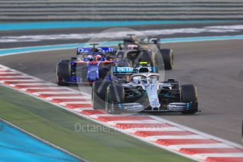 World © Octane Photographic Ltd. Formula 1 – Abu Dhabi GP - Race. Mercedes AMG Petronas Motorsport AMG F1 W10 EQ Power+ - Valtteri Bottas, Scuderia Toro Rosso STR14 – Daniil Kvyat and Haas F1 Team VF19 – Romain Grosjean. . Yas Marina Circuit, Abu Dhabi, UAE. Sunday 1st December 2019.