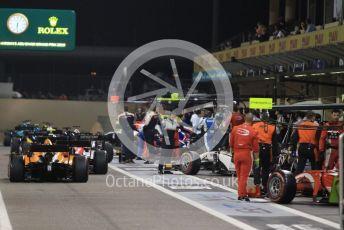 World © Octane Photographic Ltd. FIA Formula 2 (F2) – Abu Dhabi GP - Race 1. The pack heads out of the pitlane to the grid. Yas Marina Circuit, Abu Dhabi, UAE. Saturday 30th November 2019.