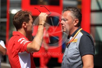 World © Octane Photographic Ltd. Formula 1 – Austrian GP - Paddock. Scuderia Ferrari SF90 – Sebastian Vettel chats with Mario Isola – Pirelli Head of Car Racing . Red Bull Ring, Spielberg, Styria, Austria. Thursday 27th June 2019