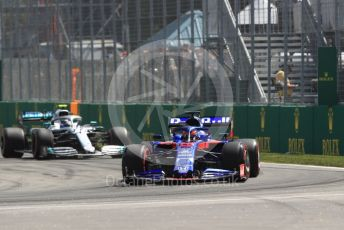 World © Octane Photographic Ltd. Formula 1 – Canadian GP. Practice 2. Scuderia Toro Rosso STR14 – Daniil Kvyat and Mercedes AMG Petronas Motorsport AMG F1 W10 EQ Power+ - Valtteri Bottas. Circuit de Gilles Villeneuve, Montreal, Canada. Friday 7th June 2019.