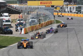 World © Octane Photographic Ltd. Formula 1 – Canadian GP. Race. McLaren MCL34 – Lando Norris, Aston Martin Red Bull Racing RB15 – Max Verstappen, Scuderia Toro Rosso STR14 – Daniil Kvyat and Lando Norris. Circuit de Gilles Villeneuve, Montreal, Canada. Sunday 9th June 2019.