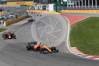 World © Octane Photographic Ltd. Formula 1 – Canadian GP. Race. McLaren MCL34 – Lando Norris and Aston Martin Red Bull Racing RB15 – Max Verstappen. Circuit de Gilles Villeneuve, Montreal, Canada. Sunday 9th June 2019.