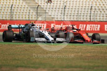 World © Octane Photographic Ltd. Formula 1 – German GP - Practice 1. Mercedes AMG Petronas Motorsport AMG F1 W10 EQ Power+ - Valtteri Bottas and Scuderia Ferrari SF90 – Sebastian Vettel. Hockenheimring, Hockenheim, Germany. Friday 26th July 2019.