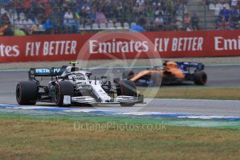 World © Octane Photographic Ltd. Formula 1 – German GP - Race. Mercedes AMG Petronas Motorsport AMG F1 W10 EQ Power+ - Valtteri Bottas and McLaren MCL34 – Carlos Sainz and Rich Energy Haas F1 Team VF19 – Kevin Magnussen. Hockenheimring, Hockenheim, Germany. Sunday 28th July 2019.