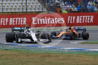 World © Octane Photographic Ltd. Formula 1 – German GP - Race. Mercedes AMG Petronas Motorsport AMG F1 W10 EQ Power+ - Valtteri Bottas and McLaren MCL34 – Carlos Sainz. Hockenheimring, Hockenheim, Germany. Sunday 28th July 2019.