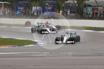 World © Octane Photographic Ltd. Formula 1 – German GP - Race. Mercedes AMG Petronas Motorsport AMG F1 W10 EQ Power+ - Lewis Hamilton and Valtteri Bottas with Alfa Romeo Racing C38 – Kimi Raikkonen. Hockenheimring, Hockenheim, Germany. Sunday 28th July 2019.