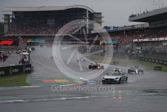 World © Octane Photographic Ltd. Formula 1 – German GP - Race. Safety car deployed ahead of he leading Lewis Hamilton, Aston Martin Red Bull Racing RB15 – Max Verstappen and Mercedes AMG Petronas Motorsport AMG F1 W10 EQ Power+ - Valtteri Bottas. Hockenheimring, Hockenheim, Germany. Sunday 28th July 2019.