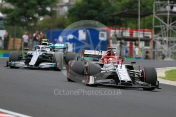 World © Octane Photographic Ltd. Formula 1 – Hungarian GP - Practice 2. Alfa Romeo Racing C38 – Kimi Raikkonen and Mercedes AMG Petronas Motorsport AMG F1 W10 EQ Power+ - Valtteri Bottas. Hungaroring, Budapest, Hungary. Friday 2nd August 2019.
