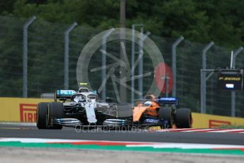 World © Octane Photographic Ltd. Formula 1 – Hungarian GP - Practice 2. Mercedes AMG Petronas Motorsport AMG F1 W10 EQ Power+ - Valtteri Bottas and McLaren MCL34 – Carlos Sainz. Hungaroring, Budapest, Hungary. Friday 2nd August 2019.
