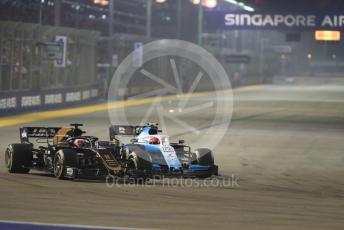 World © Octane Photographic Ltd. Formula 1 – Singapore GP - Race. Haas F1 Team VF19 – Romain Grosjean and ROKiT Williams Racing FW 42 – George Russell. Marina Bay Street Circuit, Singapore. Sunday 22nd September 2019.