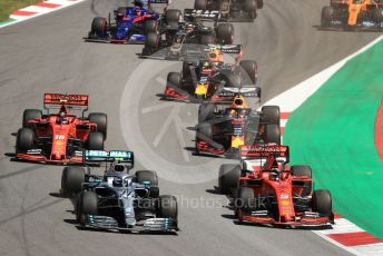 World © Octane Photographic Ltd. Formula 1 – Spanish GP. Race. Mercedes AMG Petronas Motorsport AMG F1 W10 EQ Power+ - Valtteri Bottas and Scuderia Ferrari SF90 – Sebastian Vettel. Circuit de Barcelona Catalunya, Spain. Sunday 12th May 2019.
