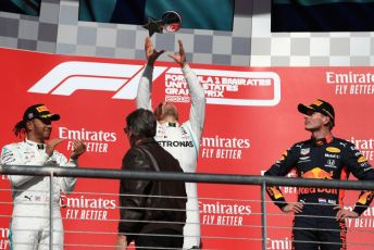 World © Octane Photographic Ltd. Formula 1 – United States GP - Podium. Mercedes AMG Petronas Motorsport AMG F1 W10 EQ Power+ - Valtteri Bottas and Lewis Hamilton  with Aston Martin Red Bull Racing RB15 – Max Verstappen. Circuit of the Americas (COTA), Austin, Texas, USA. Sunday 3rd November 2019.