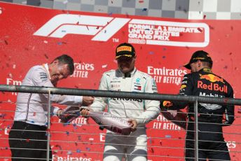 World © Octane Photographic Ltd. Formula 1 – United States GP - Podium. Mercedes AMG Petronas Motorsport AMG F1 W10 EQ Power+ - Valtteri Bottas and Technical Director James Allison  with Aston Martin Red Bull Racing RB15 – Max Verstappen. Circuit of the Americas (COTA), Austin, Texas, USA. Sunday 3rd November 2019.
