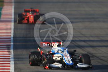 World © Octane Photographic Ltd. Formula 1 – F1 Pre-season Test 1 - Day 3. ROKiT Williams Racing FW43 – Nicholas Latifi and Scuderia Ferrari SF1000 – Sebastian Vettel. Circuit de Barcelona-Catalunya, Spain. Friday 21st February 2020.