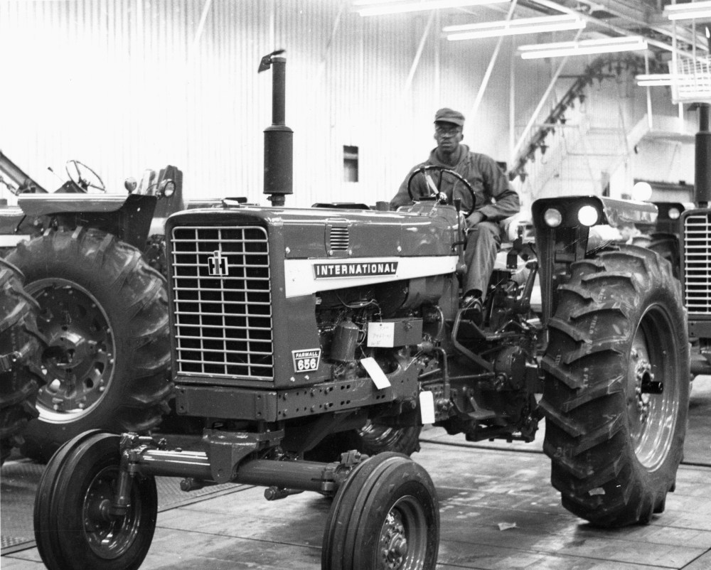 medium resolution of a worker drives a later model farmall 656 off the line on november 15 1968 note that the side panel sports the international label and farmall has